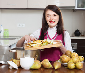 Brunette woman cooking pear jam