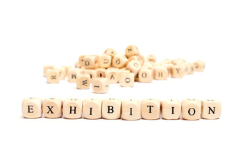 word with dice on white background- exhibition
