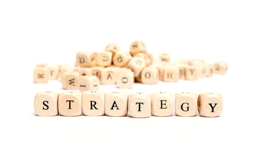 word with dice on white background- strategy