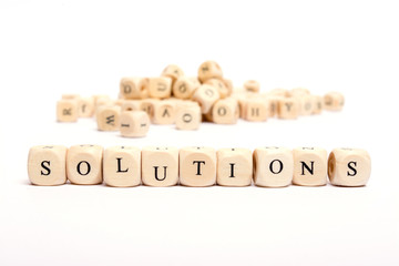 word with dice on white background- solutions