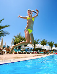 Child jump in  swimming  pool.