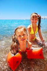 Children  playing on  beach.