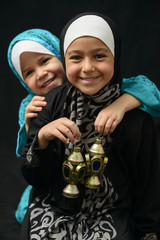 Two Happy Muslim Girls with Ramadan Lantern