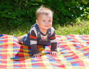 Baby on checkered plaid outdoors