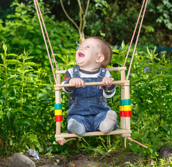 Little boy on the swing