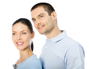Young smiling couple looking up, isolated