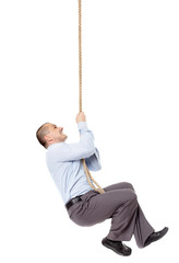 Businessman climing on a rope