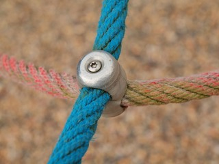 Iron joint point of ropes in children spider web with screw.