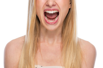 Closeup on teenager screaming
