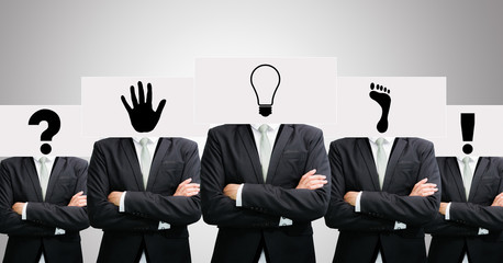 Businessman standing white paper ideas face holding front of hea