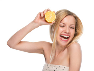Portrait of happy teenager with lemon