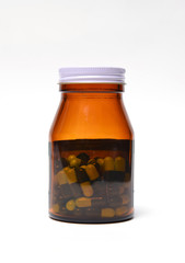 group of green capsule medicine in bottle