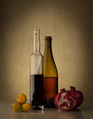Still life with two wine bottles and fruits