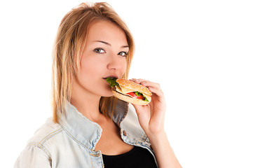 beautiful woman eating a hamburger