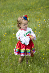 Little girl 2 years in Ukrainian traditional dress