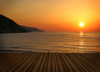 Wooden deck with sunset seascape
