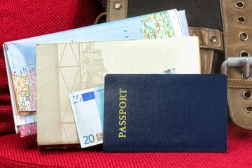 Close up of a traveling documents- passport, ticket, map
