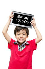 Little boy holding tablet computer word mommy I love you