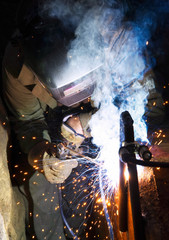 Welder on industrial workplace. Construction and manufacturing