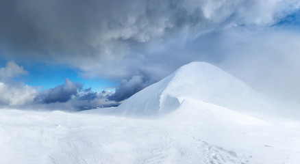 Snowy top during storm. Beautiful winter landscape
