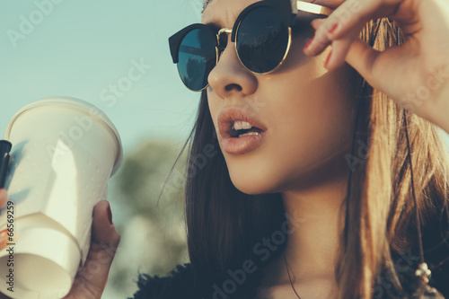 Beautiful hipster woman with cup of coffee - 66569259