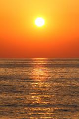 Deep orange color sunset on the beach
