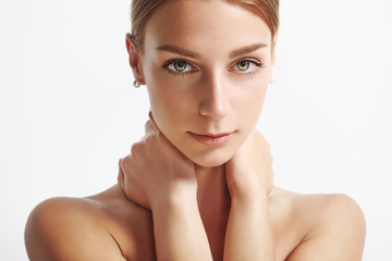 woman with ideal skin looking at camera