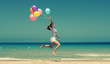 beautiful woman with colorful balloons outside - 66570670