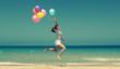 Leinwanddruck Bild - beautiful woman with colorful balloons outside