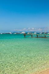 Formentera tropical Mediterranean sea wooden pier in Illetes bea