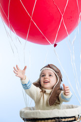 little girl playing on hot air balloon in the sky