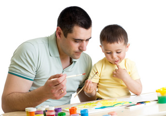 kid boy and dad paint together