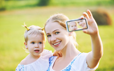 family photographing selfie themselves by phone