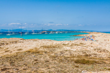 Tourists in Illetes beach Formentera island, Mediterranean sea,
