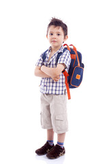 Smiling school kid standing with arms crossed against white back