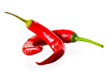 two bitter chili peppers on a white background