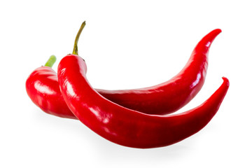 two ripe red hot chili peppers on a white background