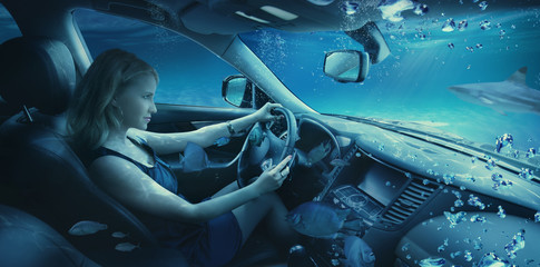 Beautiful girl underwater in the car