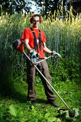 Cute gardener with lawn mower