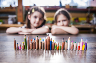 children and pencils lined up in a row