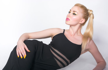Girl in black clothes, which lies on a white background.