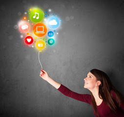 Woman holding social media balloon