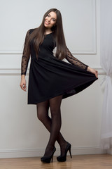 Woman in black dress full length