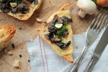 Toast bread with fresh mushrooms, cheese, garlic and fennel