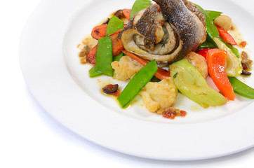 Sea bass fillet with spring vegetables and olive sauce