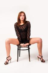 Pretty brunette girl on chair