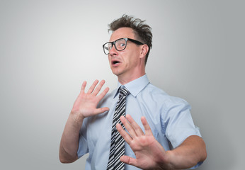 Surprised and scared businessman in glasses