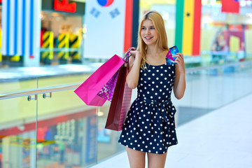 attractive woman with shopping bags and credit cards