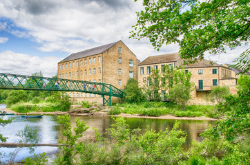 Old woollen mills by footbridge at Barnard Castle