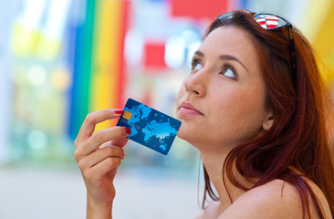 attractive woman with credit card